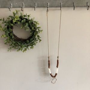 Gold, wooden and cream beaded necklace